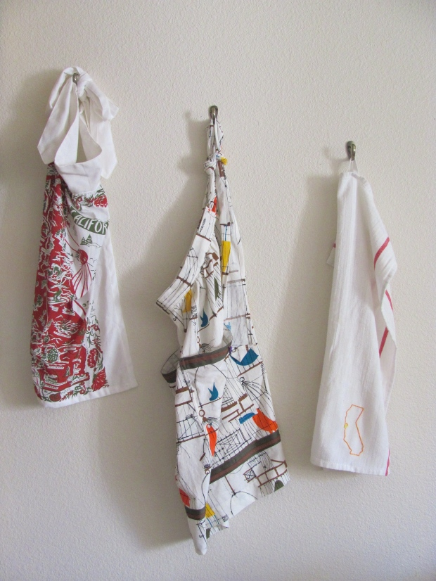 Aprons and Tea Towels via Dressed In Orange